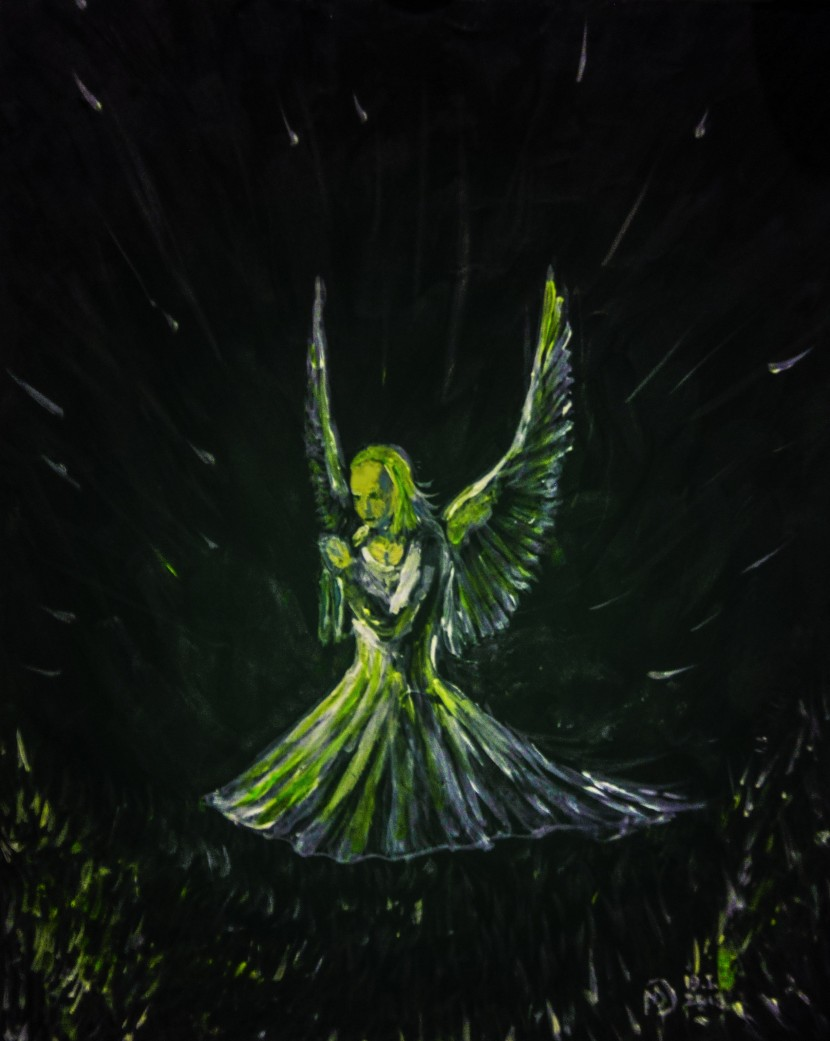 Angel praying on the grass in the night